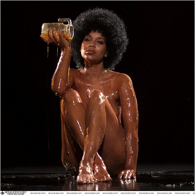 but naked women cover in honey